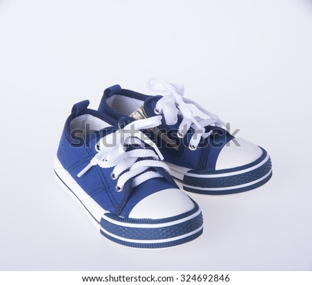 shoe. child's shoes on background. child's shoes on a background - stock photo