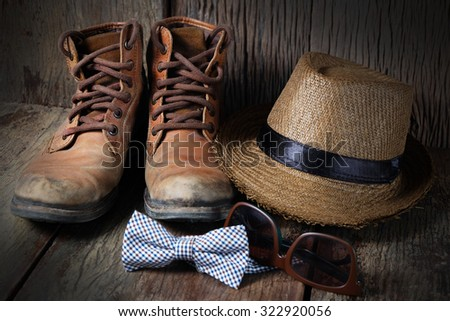 Shoe hat and accessories travel set on a wooden background
