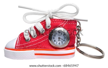 Shoe watch key chain on a white background. - stock photo