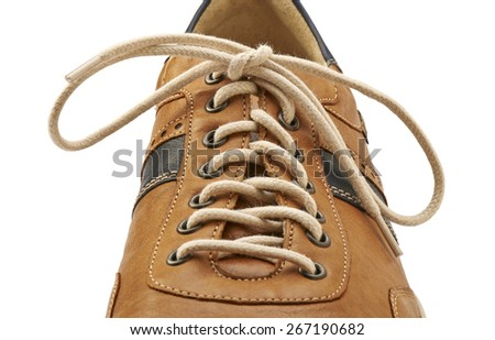 Shoelace in close up and brown shoe isolated on white - stock photo