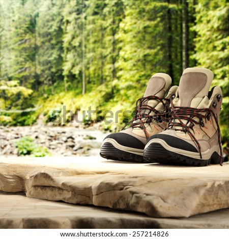 shoes and green forest landscape  - stock photo