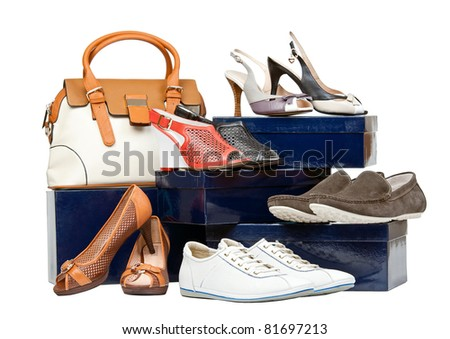Shoes and handbag on boxes over white - stock photo