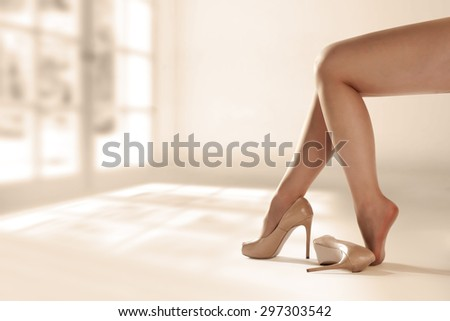 shoes and woman legs  - stock photo