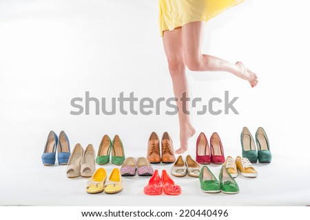 Shoes collection and female legs in fashion shoes. isolated on a white background - stock photo