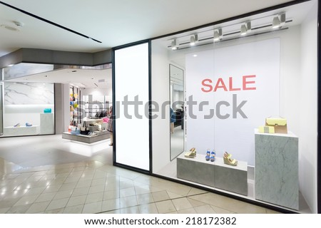 shoes display in the store window - stock photo