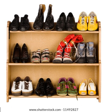 Shoes,  gym shoes, boots and other footwear stand on a rack - stock photo