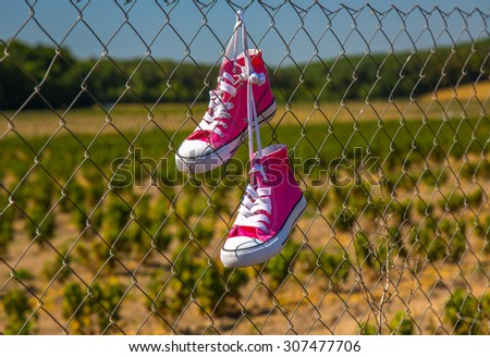 Shoes hanging on the fence
