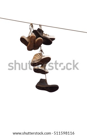 Shoes hanging on wire isolated on white background.