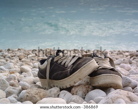 shoes on the beach - stock photo