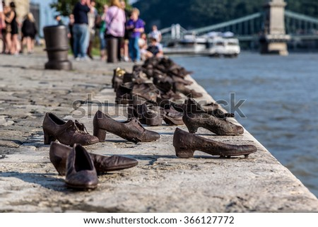 Shoes symbolizing the massacre of people shot at the river Danube in Budapest - stock photo