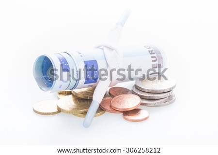 Shoestring budget concept with Euro banknotes close up - stock photo