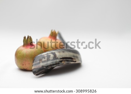 Shofar and pomegranates, isolated On a white background - rosh hashanah (jewesh holiday) concept , traditional holiday symbols.