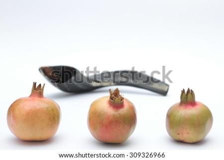 Shofar and pomegranates isolated on a white background -  traditional holiday symbols. ( Rosh Hashana ) - stock photo
