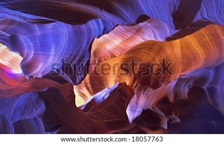 """Shone orange and violet colors a canyon of """"Antelope"""" in the USA in a bright sunny day - stock photo"""