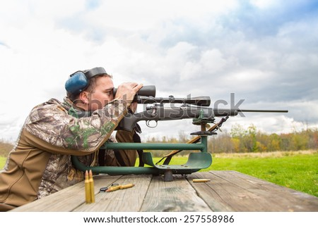 Shooter sights in rifle - stock photo