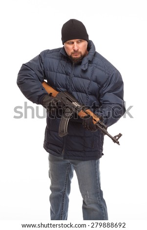 Shooter with AK 47 and cold weather gear looking angry on white background. - stock photo