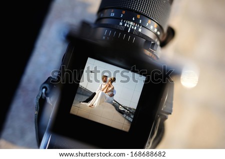 Shooting a wedding with a vintage oldschool camera - stock photo