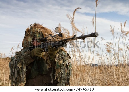 shooting camouflage sniper - stock photo