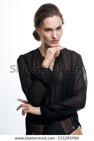 Shooting model tests. Natural beauty. Without retouching. Professional model posing,portrait of a woman on a white background