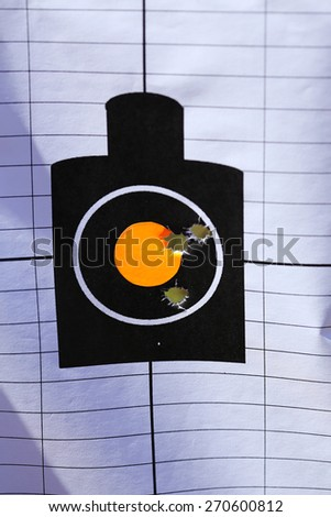 shooting range target with bullet holes - stock photo