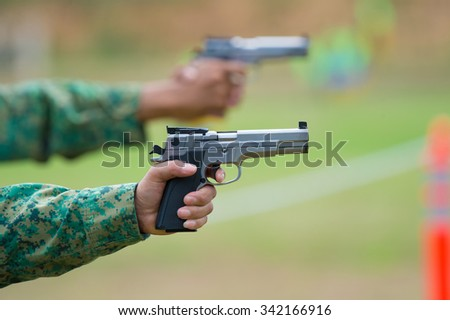 Shooting sports , female athletes ( Military) during shooting . The woman in the competition target shooting . (  - stock photo
