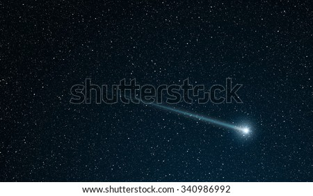 shooting star going across the star field - stock photo