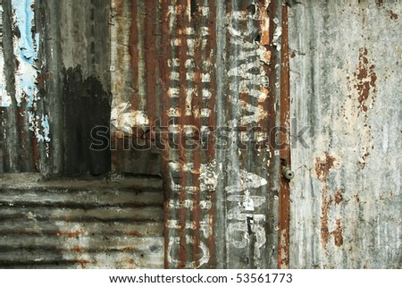 shop boarded up with corrugated iron sheeting in deprived area in the philippines, text in tagalog reads dont urinate here - stock photo