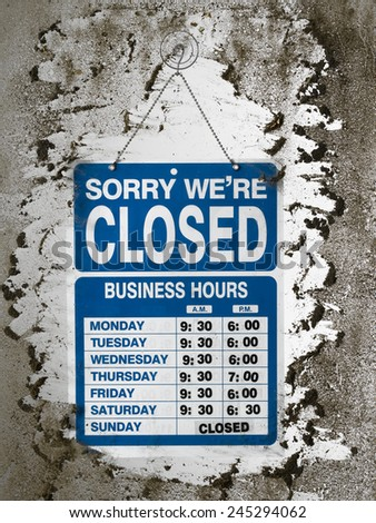 Shop sign on a dirty window - stock photo