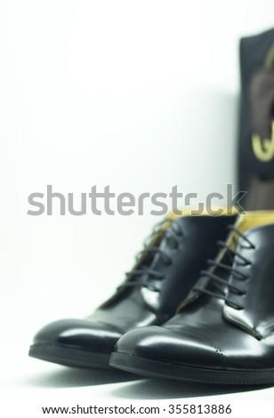 Shop window fashion store designer luxury leather shiny polished men's shoes. - stock photo