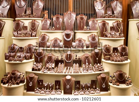 Shop window with a lot of jewellery. - stock photo
