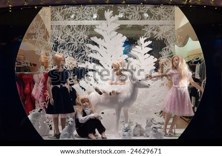 shop window with young girls - stock photo