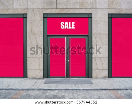 Shopfront with large windows. Shop Boutique with Sale word - stock photo