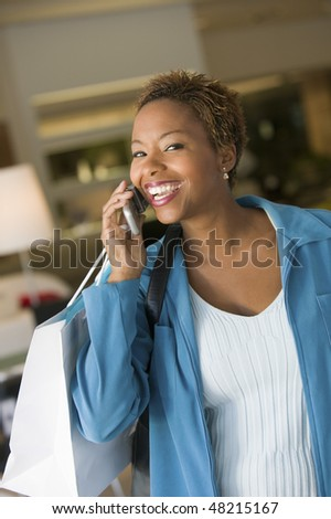 Shopper on Cell Phone - stock photo