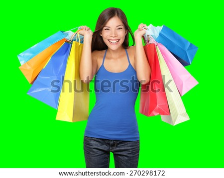Shopper woman holding shopping bags. Young beautiful shopping woman during sale holding many colorful shopping bags Isolated on green screen chroma key background. - stock photo