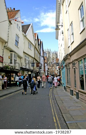 Shoppers and Tourists in York England - stock photo