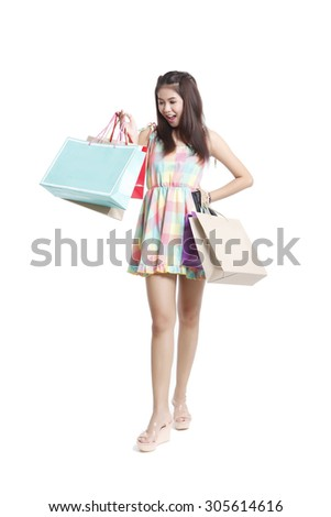 Shopping asian woman holding bags, isolated on white studio background