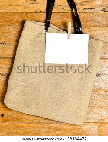 shopping bag on old wooden background for natural recycle concept - stock photo