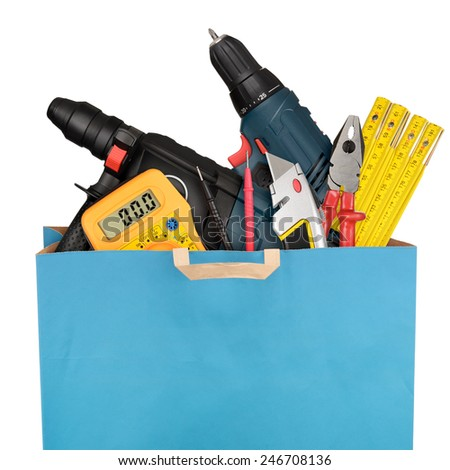 Shopping bag with a different work tools isolated on white background - stock photo