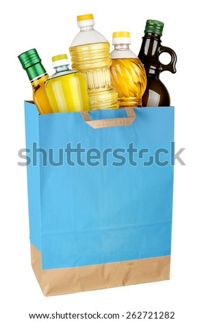 Shopping bag with cooking oil isolated on white background. Full size - stock photo