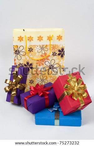 shopping bag with lots of gifts - stock photo