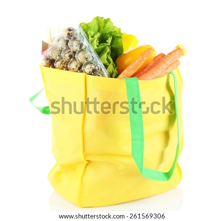 Shopping bag with set of products isolated on white background