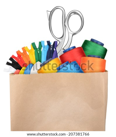 Shopping bag with sewing supplies isolated on white background - stock photo