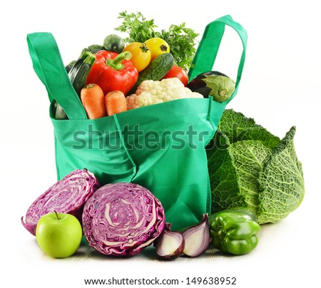 Shopping bag with variety of fresh organic vegetables isolated on white - stock photo