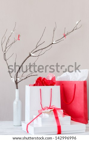 Shopping bags and present gift boxes on table top with elegant interior decoration - stock photo