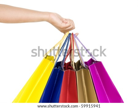 shopping bags in hand isolated on white - stock photo