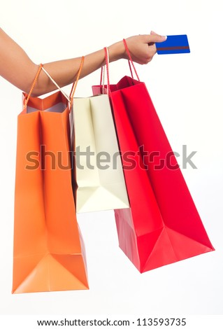 shopping bags set  and credit card in woman's hand isolated on white