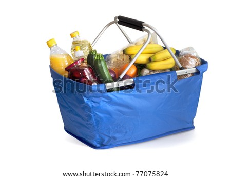 Shopping basket filled with groceries - stock photo