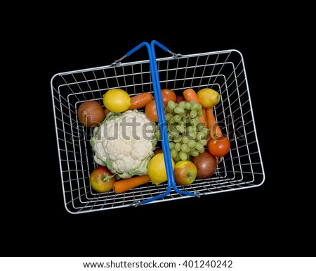 Shopping basket with fruit and vegetables - stock photo