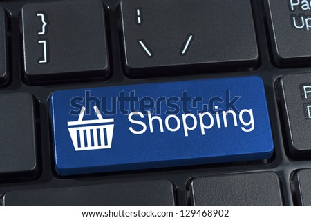 Shopping button keypad with basket icon. Internet concept of consumerism and e-commerce. - stock photo