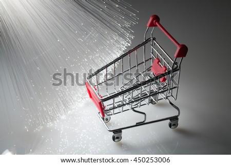 Shopping cart and Fiber optics background  - stock photo